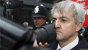 Chris Huhne comes into contact with a photographer's lens