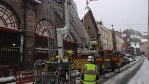 Jersey Fire officers removing ice from the town market
