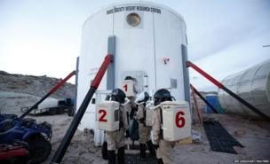 Members of Crew 125 EuroMoonMars B mission return after collecting geologic samples to be studied at the Mars Desert Research Station