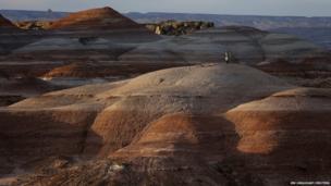 Volker Maiwald walks along rock formations