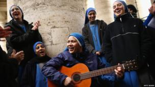 Nuns singing and playing guitar in St Peter's Square