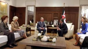 Jordan's King Abdullah II (2nd R) meets Prince Charles as Queen Rania of Jordan (R) and Camilla, Duchess of Cornwall listen in