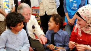 Prince Charles meets Syrian children in the nursery at King Abdullah refugee camp in Jordan on 13 March 2013