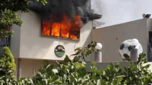 Flames rise from a room at the headquarters of the Egyptian Football Association in Cairo on 9 March 2013