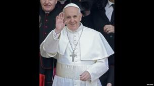 Newly elected Pope Francis waves as he leaves the Santa Maria Maggiore Basilica in Rome