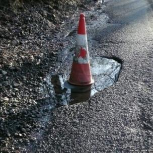 Large pothole in road, with traffic cone in it. Picture: Rachel Grenter