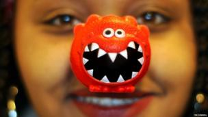 A woman smiling and wearing her red nose. Picture: Tim Dennell