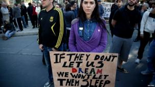 Demonstrators hold an anti-bailout rally outside the parliament in Nicosia on Monday