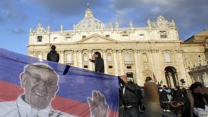Supporters of San Lorenzo de Almagro fly a club flag in St Peter's Square