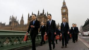 Campaigners dressed as Britain's Chancellor George Osborne