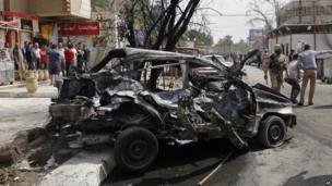 The scene of one of the car bomb attacks close to one of the main gates to Baghdad's heavily-fortified Green Zone