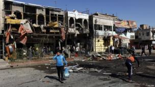 The site of a car bomb attack in the Al-Mashtal district