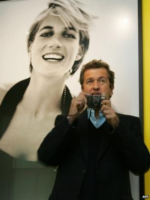 Celebrity portrait photographer Mario Testino takes a picture as he launches an exhibition of photographs that he captured of Princess Diana, 22 November 2005.
