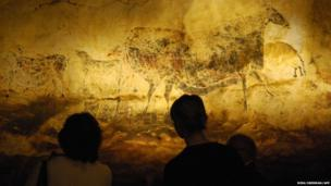 Visitors examine a copy of the 17,000-year-old Great Cow Panel