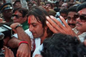 In this photograph taken on October 17, 1995, Indian Bollywood actor Sanjay Dutt (C) is mobbed by fans as he walks out of the high-security Arthur Road Jail in Mumbai, after his release on bail following bomb attacks on the western Indian city in 1993