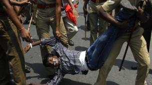 Police detain a college student during a protest in the southern Indian city of Chennai