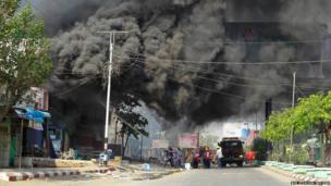 Firefighters fight a blaze in Meiktila
