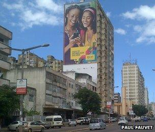 Advert on side of building for a mobile phone company in Maputo