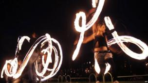 Fire acrobats perform in front of the Bulgarian National Theatre in Sofia during Earth Hour
