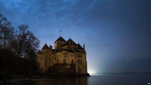 Chillon castle on the edge of Lake Geneva, seen during Earth Hour