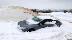 Car in snow drift