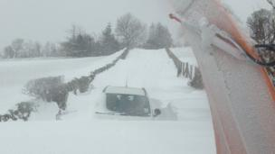 Car buried in snowdrift