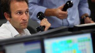 Trader watching stocks on screen