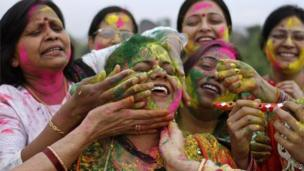 "Indian women celebrate ""Holi"", the Indian festival of colours in Allahabad, India,"
