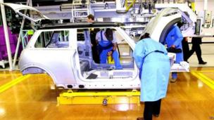 The production line at the Cowley car plant, Oxford, marking the official opening of BMWs new Mini plant.