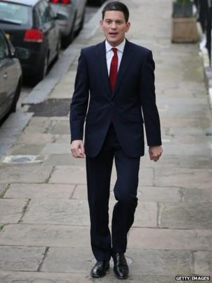 Former UK Foreign Secretary David Miliband walks near his home in London, 27 March