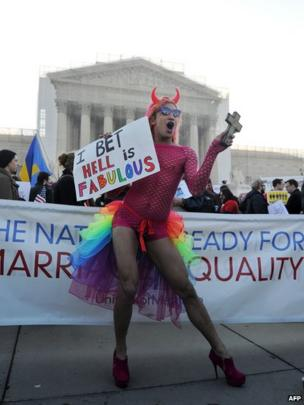 A man dances in support of gay rights in front of the US Supreme Court in Washington DC, 26 March