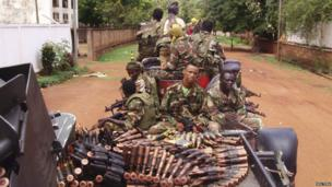 Armed fighters from the Seleka rebel alliance patrol the streets in pick-up trucks to stop looting in Bangui, Central African Republic, 26 March