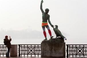 Swiss artist Hermann Hubacher's statue Ganymede on the banks of Lake Zurich is decorated with a yarn bomb