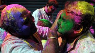 People covering each other in paint. Photo: Abhishek Debbarma