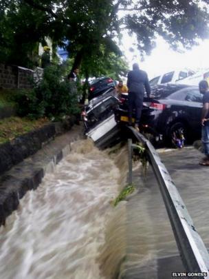 Cars swept into gutter at roadside