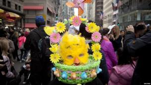 Max dressed up in a bonnet in the style of an Easter egg basket