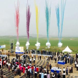 South and North Koreans take part in a ground-breaking ceremony in Kaesong,, 30 June 2003