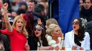 Woman cheering on horses at Aintree