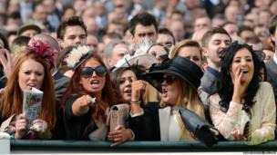 Racegoers react during the John Smith's Mildmay Novices steeple chase on the second day of the Grand National meeting at Aintree