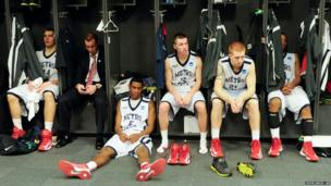 Metro State players sit in the locker room