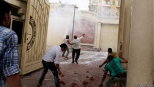 Coptic Christians throw stones inside the main cathedral during clashes