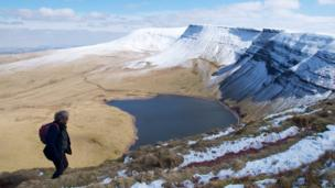 Walker above Llyn y Fan Fach