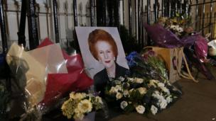 Flowers placed by well-wishers surround a portrait of former British prime minister Margaret Thatcher outside her home in Belgravia, London.