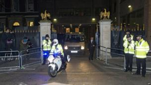 A private ambulance is escorted by a police outrider as it leaves the Ritz hotel in London on 8 April 2013 following the death of former British prime minister Margaret Thatcher, who was staying at the hotel.
