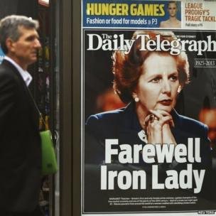 A man walks in front of a news stand with the portrait of former British prime minister Margaret Thatcher in Sydney on 9 April.