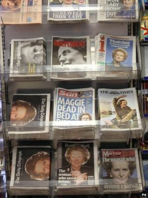A view of the front pages of national newspapers on a news stand in central London, the day after Baroness Thatcher died at the age of 87.