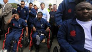 President Juan Manuel Santos pushes a soldier in a wheelchair during the march for peace in Bogota.