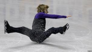 Canada's Kevin Reynolds falls at the ISU World Team Trophy in Figure Skating in Tokyo, Japan, 11 April 2013