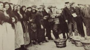 People standing round baskets