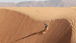 A competitor tears down a dune in Morocco on 10 April 2013